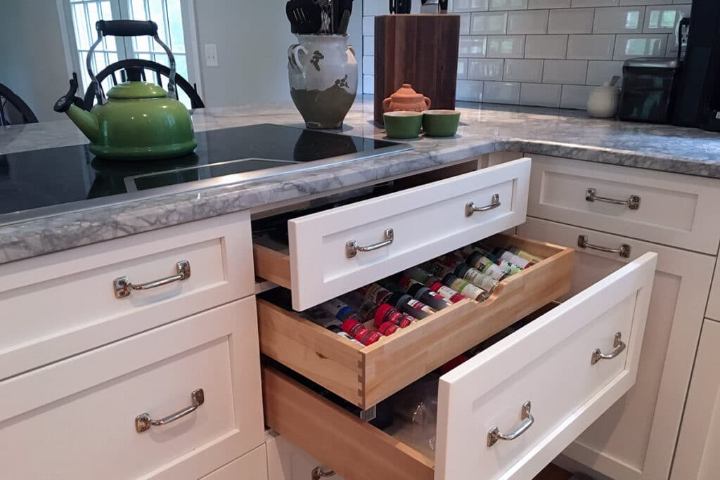 Three drawers open in kitchen