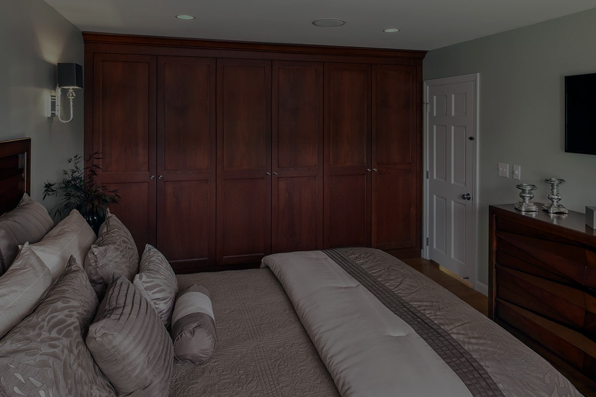 Bedroom with bed and large dresser in back